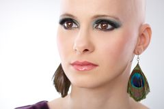 Studio portrait of bald woman. Looking away Royalty Free Stock Image