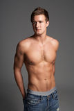 Studio Portrait Of Bare Chested Muscular Young Man Royalty Free Stock Image