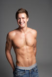 Studio Portrait Of Bare Chested Muscular Young Man Royalty Free Stock Photos