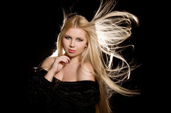 Studio portrait of beautiful blonde girl Royalty Free Stock Photography