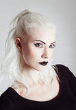 Studio portrait of beautiful blonde girl. Closeup Royalty Free Stock Photo