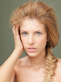 Studio portrait beautiful blonde woman blue eyes Royalty Free Stock Photo