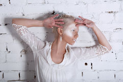 Studio portrait of beautiful blonde woman with white makeup Royalty Free Stock Images