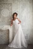 Studio portrait of beautiful bride with perfect hairstyle and ma Stock Photos