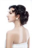 Studio portrait of a beautiful brunette with evening hairdo and Stock Image