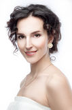 Studio portrait of a beautiful brunette with evening hairdo and Royalty Free Stock Images
