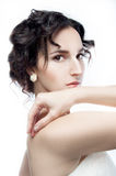 Studio portrait of a beautiful brunette with evening hairdo and Royalty Free Stock Photography