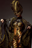 Studio portrait of beautiful model with fantasy golden butterfly body art stock image