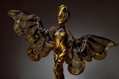 Studio portrait of beautiful model with fantasy golden butterfly body art. And crown Royalty Free Stock Photo
