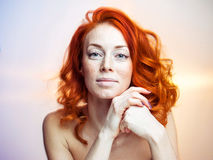 Studio portrait of a beautiful redhead woman. Studio portrait of a beautiful redhead freckled woman. Concept of health, natural beauty royalty free stock image