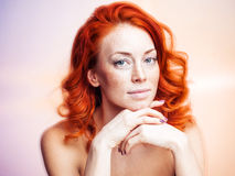 Studio portrait of a beautiful redhead woman Stock Photography