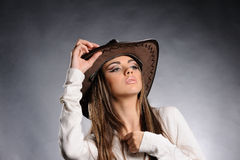 Studio portrait of beautiful sexy girl in the hat Stock Photos