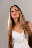 Studio portrait of beautiful girl in fashion style. On gray background royalty free stock photo