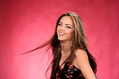 Studio portrait of beautiful girl on red background. Studio portrait of beautiful girl in fashion style stock images