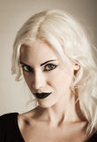 Studio portrait of beautiful vamp girl. Closeup Stock Photos