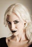 Studio portrait of beautiful vamp girl. Closeup. Studio portrait of a beautiful vamp girl. Closeup Stock Photos