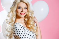 Studio portrait of the beautiful woman with balloons stock images