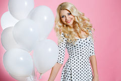 Studio portrait of the beautiful woman with balloons Royalty Free Stock Images