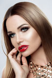 Studio Portrait of Beautiful Woman with clean skin Makeup luxury, Red plump Lips, perfect eyebrows and eyes. Girl with Royalty Free Stock Photography