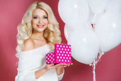 Studio portrait of a beautiful woman with a gift Royalty Free Stock Images