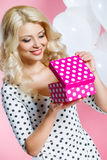 Studio portrait of a beautiful woman with a gift Royalty Free Stock Photos