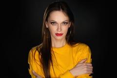 Studio portrait of a beautiful woman stock photography