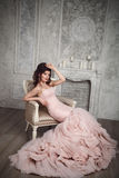 Studio portrait of beautiful young bride in pink dress Royalty Free Stock Photos