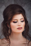 Studio portrait of beautiful young bride in pink dress Royalty Free Stock Images