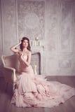 Studio portrait of beautiful young bride in pink dress Stock Photos
