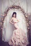 Studio portrait of beautiful young bride in pink dress Royalty Free Stock Photo