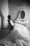 Studio portrait of beautiful young bride in white dress. Black a Royalty Free Stock Photography