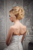 Studio portrait of beautiful young bride in white dress. Blond h Royalty Free Stock Image