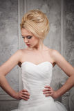 Studio portrait of beautiful young bride in white dress Stock Image