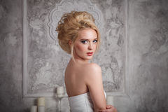 Studio portrait of beautiful young bride in white dress Royalty Free Stock Image