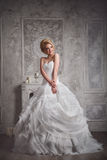 Studio portrait of beautiful young bride in white dress Royalty Free Stock Photography