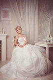 Studio portrait of beautiful young bride in white dress Stock Photo