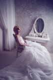 Studio portrait of beautiful young bride in white dress Royalty Free Stock Images