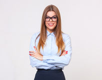 Studio portrait of beautiful young business woman on  gray backg Royalty Free Stock Photo