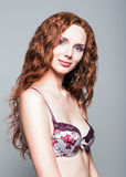 Studio portrait of beautiful young redhead woman Royalty Free Stock Images