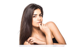 Studio portrait of a beautiful young woman with brown hair. Pretty model girl with perfect fresh clean skin. Beauty and skin care Stock Photo