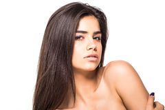 Studio portrait of a beautiful young woman with brown hair. Pretty model girl with perfect fresh clean skin. Beauty and skin care Stock Photos