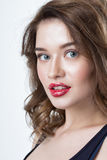 Studio portrait of a beautiful young woman. Fashion Makeup Model with perfect makeup, red lips and smooth, clean skin. Highlighter Royalty Free Stock Photos