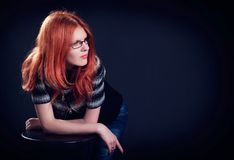 Studio portrait of the beautiful young woman with ginger hair Royalty Free Stock Images