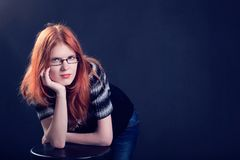 Studio portrait of the beautiful young woman with ginger hair Royalty Free Stock Photos