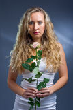 Studio portrait of a beautiful young woman with ro Stock Photography