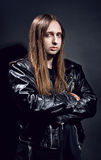 Studio portrait of biker in leather jacket Stock Images