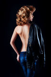 Studio portrait of blonde woman with leather biker jacket. Look Stock Image