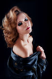 Studio portrait of blonde woman with leather biker jacket. Look Stock Images