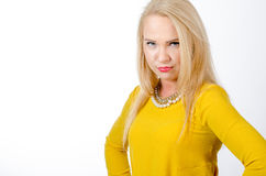 Studio portrait of a blonde woman wearing yellow dress Royalty Free Stock Photos