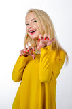 Studio portrait of a blonde woman wearing yellow dress Stock Photo